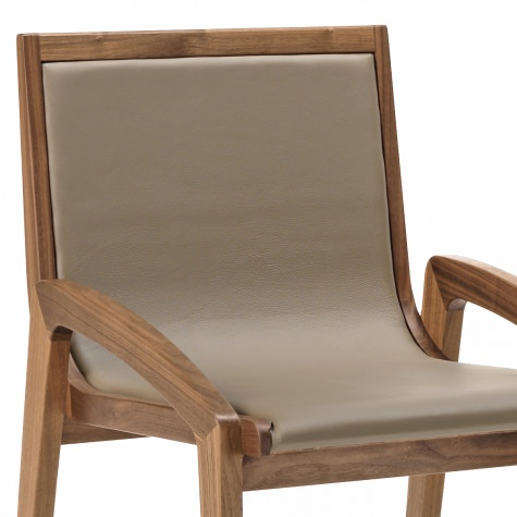 Upholstered chiar in solid walnut or oak with seat and back in leather