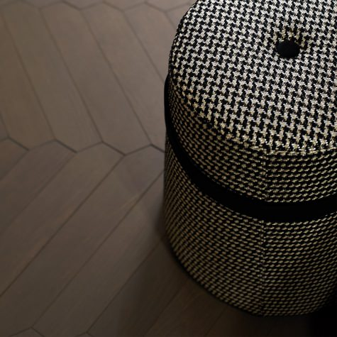 Upholstered pouf with circular base