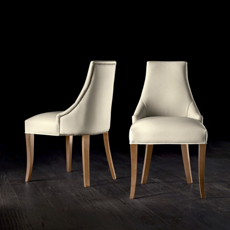 Upholstered chair in solid walnut or oak