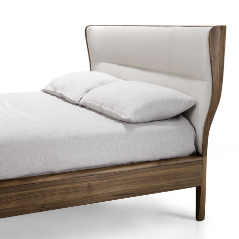 Upholstered bed in solid walnut