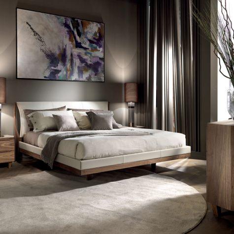 Upholstered bed in solid walnut or oak
